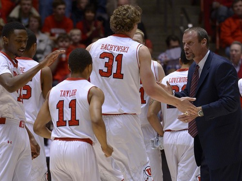 Leah Hogsten  |  The Salt Lake Tribune Utah Utes head coach Larry Krystkowiak celebrates the steals by Utah Utes center Dallin Bachynski (31) during a timeout. The University of Utah defeated Oregon State 80-69 during their game Saturday, January 4, 2014 at the Huntsman Center.