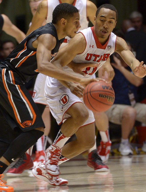 Leah Hogsten  |  The Salt Lake Tribune Utah Utes guard Brandon Taylor (11) tries to steal the ball from Oregon State Beavers guard Hallice Cooke (3). The University of Utah defeated Oregon State 80-69 during their game Saturday, January 4, 2014 at the Huntsman Center.