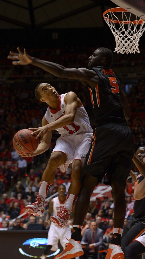 Leah Hogsten  |  The Salt Lake Tribune Utah Utes guard Brandon Taylor (11) tries to round Oregon State Beavers center Cheikh N'diaye (5) and draws a foul. The University of Utah defeated Oregon State 80-69 during their game Saturday, January 4, 2014 at the Huntsman Center.
