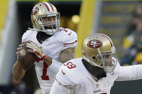 San Francisco 49ers quarterback Colin Kaepernick (7) looks for a receiver during the first half of an NFL wild-card playoff football game against the Green Bay Packers, Sunday, Jan. 5, 2014, in Green Bay, Wis. (AP Photo/Mike Roemer)