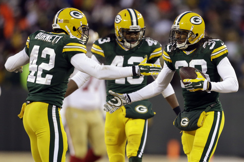 Green Bay Packers cornerback Tramon Williams (38) celebrates an interception with strong safety Morgan Burnett (42) and free safety M.D. Jennings (43) during the first half of an NFL wild-card playoff football game against the San Francisco 49ers , Sunday, Jan. 5, 2014, in Green Bay, Wis. (AP Photo/Jeffrey Phelps)