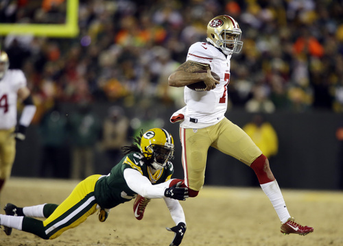 San Francisco 49ers quarterback Colin Kaepernick (7) runs against Green Bay Packers cornerback Davon House (31) during the first half of an NFL wild-card playoff football game, Sunday, Jan. 5, 2014, in Green Bay, Wis. (AP Photo/Jeffrey Phelps)