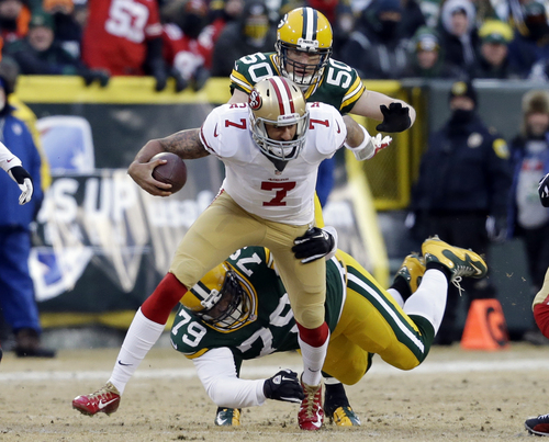 Green Bay Packers nose tackle Ryan Pickett (79) tackles San Francisco 49ers quarterback Colin Kaepernick (7) during the first half of an NFL wild-card playoff football game, Sunday, Jan. 5, 2014, in Green Bay, Wis. (AP Photo/Mike Roemer)