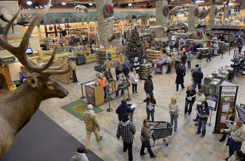 Al Hartmann  |  Tribune file photo First shoppers enter Cabela's in Lehi the Friday after Thanksgiving 2013. An indicator of Utah's strong economy is consumer confidence. The latest Zions Bank Consumer Attitude Index (CAI), which surveys 500 Utahns about the economy, reached a record high of 96.1 from November to December of last year. Holiday shopping was up in 2013. More people believed their annual household income would rise in the next six months than the same period the year before, according to the survey, and there was increased optimism over business conditions in Utah and residents' feelings about the value of their homes.