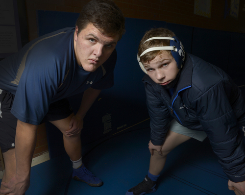 Rick Egan  | The Salt Lake Tribune   Zac Dawe (left) and Ben Anderson (right) wrestle for Pleasant Grove High school. Monday, January 6, 2014.
