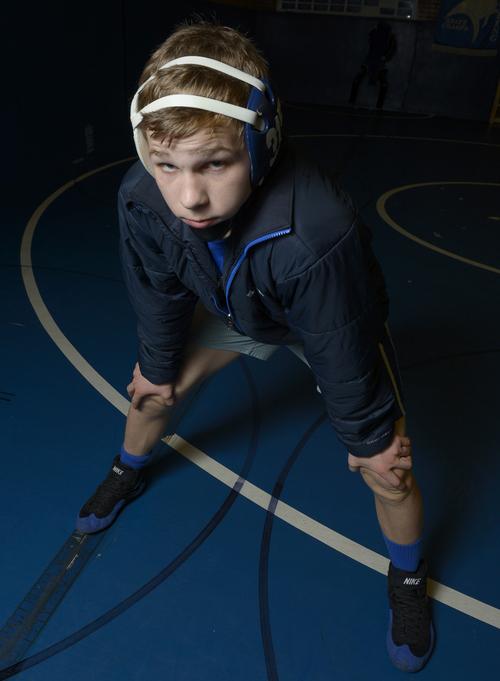 Rick Egan  | The Salt Lake Tribune     Ben Anderson wrestles for Pleasant Grove High school. Monday, January 6, 2014.
