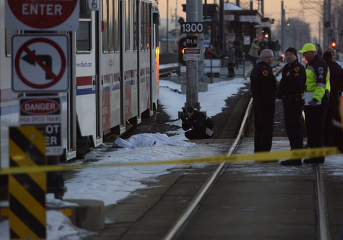 Rick Egan  | The Salt Lake Tribune   A pedestrian was hit by a Trax train near 200 west 1180 south in Salt Lake, Monday, January 6, 2014.