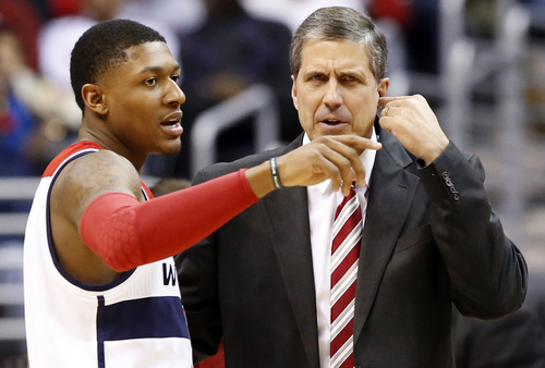 Washington Wizards guard Bradley Beal, left, talks with head coach Randy Wittman in the first half of an NBA basketball game against the Golden State Warriors, Sunday, Jan. 5, 2014, in Washington. The Warriors won 112-96 for the team's ninth win in a row. (AP Photo/Alex Brandon)