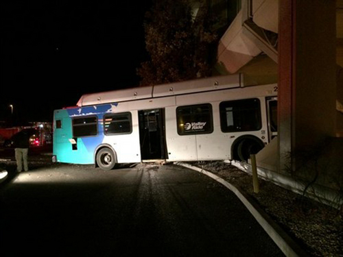In this photo provided by the Boise Fire Department via the Boise Police Department, a city passenger bus is shown that has crashed into the Idaho Power corporate headquarters building, early Monday, Jan. 6, 2014, in Boise, Idaho. Police say the brakes failed on the bus causing the driver to swerve through a parking lot before crashing into the building. (AP Photo/Boise Fire Department via Boise Police Department, Battalion Chief Aaron Hummel)