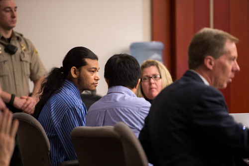 Trent Nelson  |  The Salt Lake Tribune Esar Met, left, sits with his defense team and translator at the beginning of his murder trial in Salt Lake City, Tuesday Jan. 7, 2014. Met is accused of killing 7-year-old Hser Ner Moo in 2008.