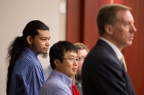 Trent Nelson  |  The Salt Lake Tribune Esar Met, far left, stands with his defense team and translator as the jury enters at the beginning of his murder trial in Salt Lake City, Tuesday Jan. 7, 2014. Met is accused of killing 7-year-old Hser Ner Moo in 2008.