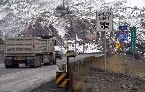 Francisco Kjolseth  |  The Salt Lake Tribune Traffic rolls along I-80 in Parley's Canyon on Tuesday, Jan. 7, 2013, where UDOT has been switching to new electronic speed limit signs that will change the limit according to conditions.