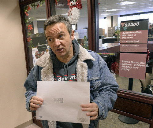 Al Hartmann  |  The Salt Lake Tribune Michael Braxton, who legally performed a marriage for a same sex couple on Saturday, arrives at the Salt Lake County Clerk' Office Monday Jan. 6, 2014, to register the marriage certificate a few minutes after the Supreme Court issued a stay to Utah's gay marriage ruling. He was a worried that the ruling would affect the legality of the marriage but since it took place before the stay the clerk's office recorded it.