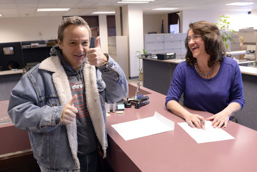 Al Hartmann  |  The Salt Lake Tribune Michael Braxton, who legally performed a marriage for a same sex couple on Saturday, records the certificate with Deputy Clerk Wany Santos Morrison with Salt Lake County Clerk's Office Monday Jan. 6, 2014.  He was  worried that the Supreme Court stay would affect the legality of the marriage but since it took place before the stay the clerk's office recorded it. He was relieved and gave a thumbs up when the officer recorded  the license.