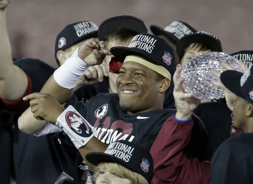 Florida State's Jameis Winston celebrates with teammates after the NCAA BCS National Championship college football game against Auburn Monday, Jan. 6, 2014, in Pasadena, Calif. Florida State won 34-31. (AP Photo/Chris Carlson)