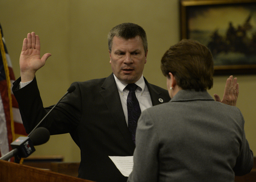 Rick Egan  | The Salt Lake Tribune   Council member Steve Buhler is sworn in by city recorder Sheri McKendrick at West Valley City Hall, Monday, January 6, 2014.