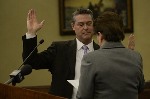 Rick Egan  | The Salt Lake Tribune   Council member Steve Vincent is sworn in by city recorder Sheri McKendrick at West Valley City Hall, Monday, January 6, 2014.
