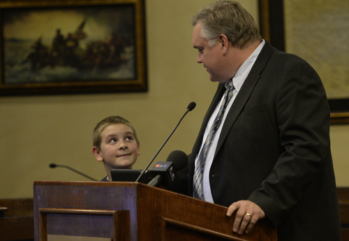 Rick Egan  | The Salt Lake Tribune   Council member Lars Nordfelt says a few words to the crowd with his son Gideon at his side during the swearing-in ceremony at West Valley City Hall, Monday, January 6, 2014.