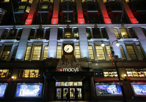 FILE - In this Tuesday, Dec. 17, 2013, file photo, Macy's department store in Herald Square is illuminated with holiday lighting, in New York.   Macy's said Wednesday, Jan. 8, 2014, it is laying off 2,500 workers as it restructures business. (AP Photo/Mark Lennihan, File)