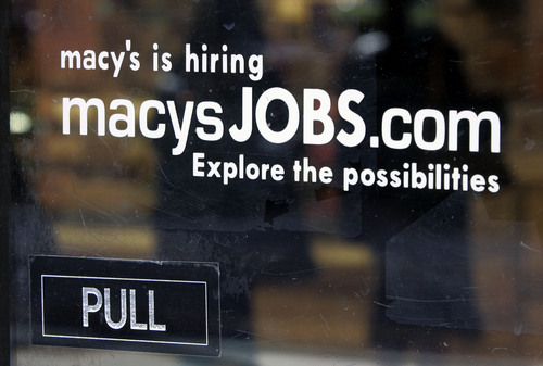 FILE - In this Monday, Feb. 2, 2009, file photo, a hiring sign is displayed on the front door of a Macy's store in Palo Alto, Calif.  Macy's announced Wednesday, Jan. 8, 2014, that it is laying off 2,500 workers as it restructures business. (AP Photo/Paul Sakuma, File)