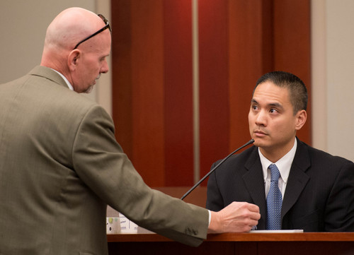 Trent Nelson  |  The Salt Lake Tribune Defense attorney John West questions FBI agent James Lamadrid at the murder trial of Esar Met in Salt Lake City, Tuesday Jan. 7, 2014. Met is accused of killing 7-year-old Hser Ner Moo in 2008. Lamadrid found the body of Hser Ner Moo in the basement of an apartment.