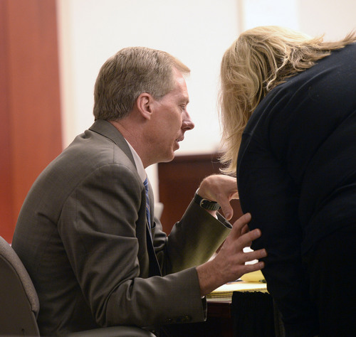 Al Hartmann  |  The Salt Lake Tribune Esar Met's defense lawyers Michael Peterson and Densie Porter confer during cross examination of Hser Ner Moo's father Cartoon  Wah in Salt Lake City  Wednesday Jan. 8, 2014 for Met's murder trial.  Esar Met is accused of killing 7-year-old Hser Ner Moo, who disappeared on March 31, 2008.