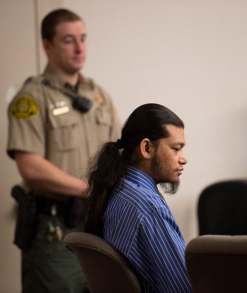 Trent Nelson     The Salt Lake Tribune Esar met listens during his murder trial in Salt Lake City, Tuesday Jan. 7, 2014. Met is accused of killing 7-year-old Hser Ner Moo in 2008.