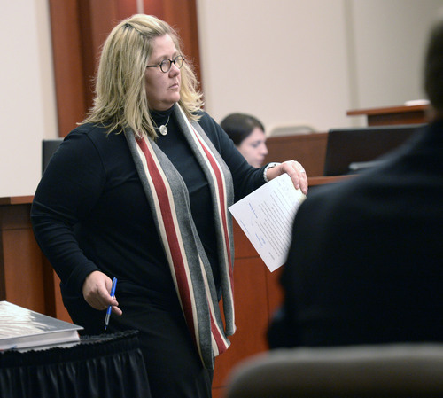 Al Hartmann  |  The Salt Lake Tribune Esar Met's defense lawyer Denise Porter cross examines Hser Ner Moo's father, Cartoon Wah in Salt Lake City  Wednesday Jan. 8, 2014. Esar Met is accused of killing 7-year-old Hser Ner Moo, who disappeared on March 31, 2008.
