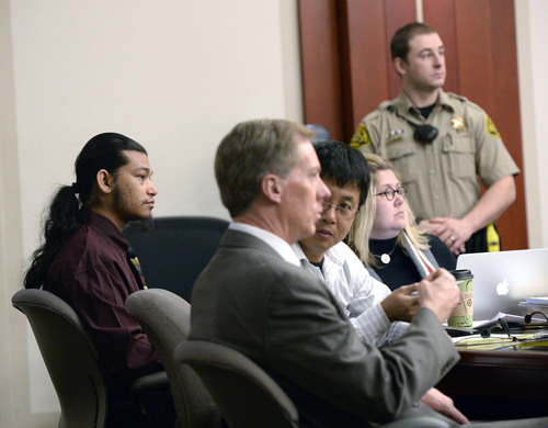 Al Hartmann  |  The Salt Lake Tribune Esar Met, left, sits with his defense team and interpreter in Judge Judith Atherton's courtroom in Salt Lake City  Wednesday Jan. 8, 2014 for his murder trial. He is accused of killing 7-year-old Hser Ner Moo, who disappeared on March 31, 2008.