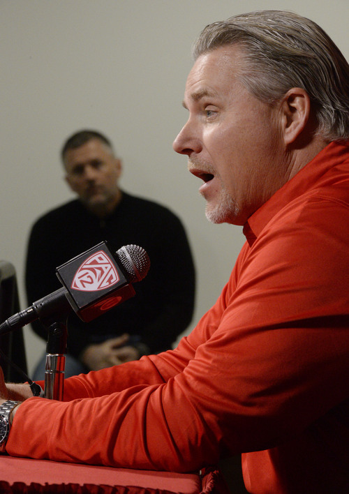 Francisco Kjolseth  |  The Salt Lake Tribune Dave Christensen, Utah's newest offensive coordinator is introduced during a press conference at the University of Utah football practice facility on Tuesday, Jan. 7. 2014, as coach Kyle Whittingham listens in.