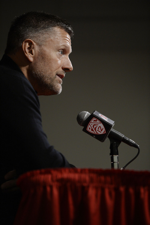 Francisco Kjolseth  |  The Salt Lake Tribune Coach Kyle Whittingham answers questions from the media following an introduction of Dave Christensen, Utah's newest offensive coordinator during a press conference at the University of Utah football practice facility on Tuesday, Jan. 7. 2014.