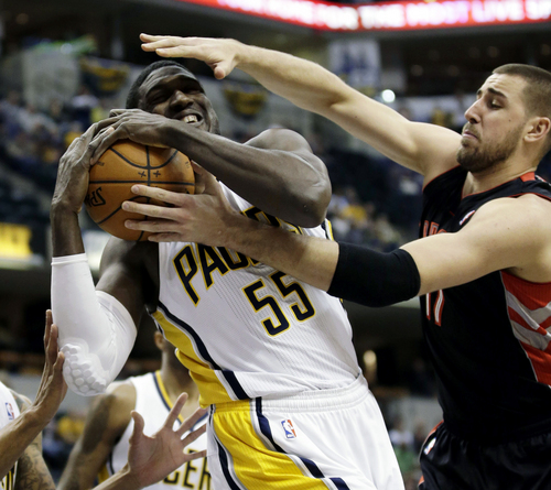 Indiana Pacers center Roy Hibbert, left, pulls in a rebound in front of Toronto Raptors center Jonas Valanciunas, of Venezuela, during the first half of an NBA basketball game in Indianapolis, Tuesday, Jan. 7, 2014. (AP Photo/AJ Mast)