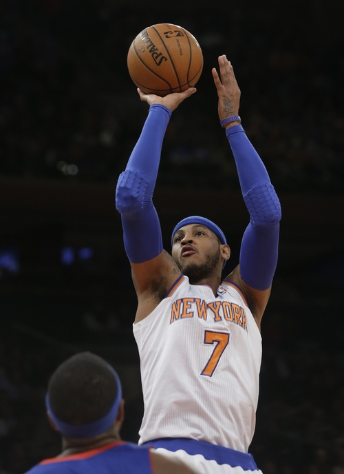 New York Knicks' Carmelo Anthony (7) shoots over Detroit Pistons' Josh Smith during the first half of an NBA Basketball game Tuesday, Jan. 7, 2014, in New York.  (AP Photo/Frank Franklin II)