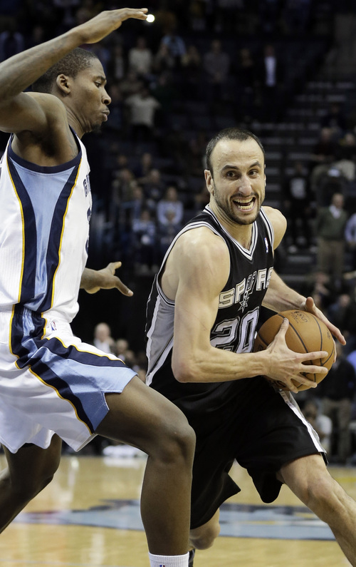 San Antonio Spurs' Manu Ginobili (20), of Argentina, drives past Memphis Grizzlies' Ed Davis, left, to the basket in the the last seconds of overtime in an NBA basketball game in Memphis, Tenn., Tuesday, Jan. 7, 2014. The Spurs defeated the Grizzlies 110-108 in overtime. (AP Photo/Danny Johnston)