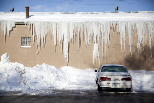 Icicles hang from the Roger's Foam building Thursday, Jan. 9, 2014, in Flint, Mich. Temperatures dropped to minus 15 in Flint after warming up a bit Wednesday. (AP Photo/The Flint Journal, Michelle Tessier) LOCAL TV OUT; LOCAL INTERNET OUT