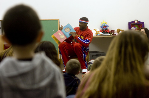 "|  Tribune file photo Harlem Globetrotter Anthony ""Buckets"" Blakes reads a story to kids during story hour at the Salt Lake Main Library in celebration of the library's 10th anniversary in Salt Lake City on Feb. 8, 2013. Such book gatherings are anchored in the state's history of book clubs that helped to civilize the West."