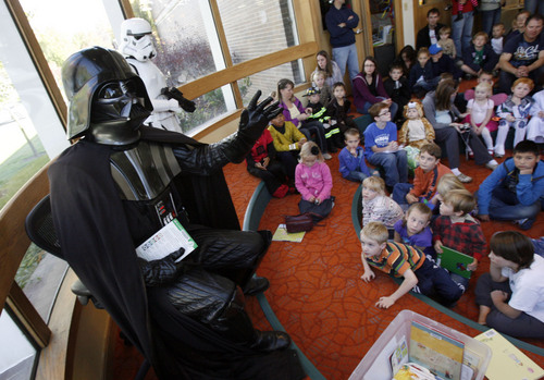 Francisco Kjolseth  |  Tribune file photo Darth Vader leads the story hour as Star Wars characters pose for photographs, sign autographs and read stories out loud as part of a Murray Library fundraiser on Saturday, October 29, 2011. Such events are part of Utah's history of literary gatherings that helped civilize the West.