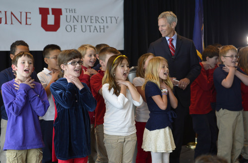 Rick Egan  | The Salt Lake Tribune   Salt Lake City Mayor Ralph Becker listens to fourth-graders from Whittier Elementary School sing a song about air pollution as part of his 2014 presentation of the State of the City Address in the Varsity Room on the 6th floor of the Rice-Eccles Stadium & Tower, Wednesday, January 8, 2014.