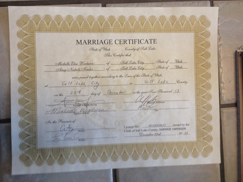 """Marissa Lang     The Salt Lake Tribune Michelle """"Pidge"""" Winburn and Amy Fowler were married Monday, Dec. 23 at the Salt Lake County clerk's office. This was the marriage certificate they were issued, making their nuptials among the first same-sex unions legally recognized in the state of Utah."""