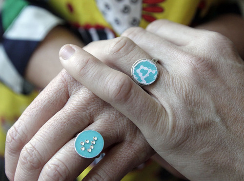 Leah Hogsten  |  The Salt Lake Tribune Newlyweds Pidge Winburn and Amy Fowler celebrated Christmas Day brunch with friends at their home. The two show off their wedding rings that a friend got them; an A for Amy and a P for Pidge. The two were married Dec. 23, 2013.