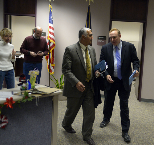 Keith Johnson   The Salt Lake Tribune  Utah Sen. Jim Dabakis (right) and Salt Lake District Attorney Sim Gill leave the Salt Lake County clerks office, Friday, December 20, 2013. Sen. Dabakis was trying to keep the clerks office open late Friday to accommodate more same sex couples seeking marriage licenses. A federal judge in Utah Friday struck down the state's ban on same-sex marriage, saying the law violates the U.S. Constitution's guarantees of equal protection and due process.