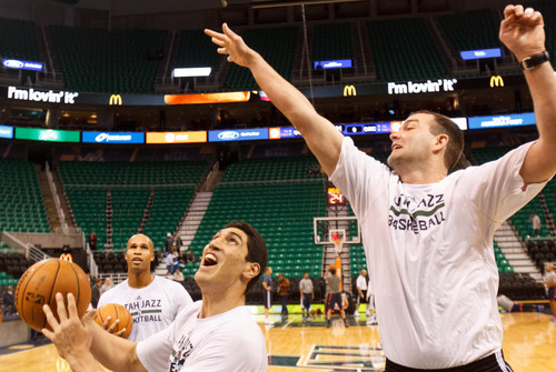 Trent Nelson  |  The Salt Lake Tribune Utah Jazz center Enes Kanter (0) shoots over assistant coach Alex Jensen during warmups as the Utah Jazz host the Oklahoma City Thunder, NBA Basketball at EnergySolutions Arena in Salt Lake City, Wednesday October 30, 2013.