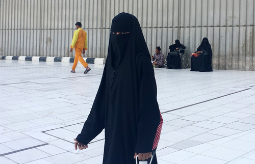 Aya Batrawy  |  The Associated Press A veiled woman walking in Mecca, Saudi Arabia, where society is governed by a mix of ancient customs and conservative interpretations of Islam. Most women cover their face and by law must wear long flowing black abayas in public.