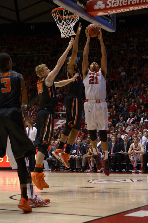 Leah Hogsten  |  The Salt Lake Tribune Utah Utes forward Jordan Loveridge (21) for two. The University of Utah defeated Oregon State 80-69 during their game Saturday, January 4, 2014 at the Huntsman Center.
