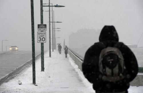 Al Hartmann  |  The Salt Lake Tribune People cross the bridge over North Temple in Salt Lake City during a snowstorm Thursday Jan. 9, 2014.