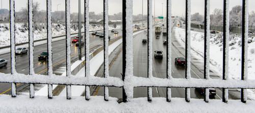 Trent Nelson  |  The Salt Lake Tribune Traffic along I-15 during a snowy day, Thursday January 9, 2014 in Salt Lake City.