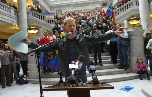 Rick Egan  | The Salt Lake Tribune   Troy Williams, a local radio producer and gay activist, said the spirit and passion of past civil rights movements is alive in Utah during a rally at the Utah State Capitol, Friday, Jan. 10, 2014.