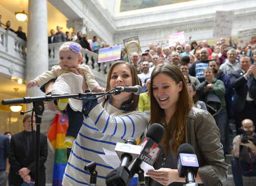 Rick Egan  | The Salt Lake Tribune   Megan Berrett and Candice Berrett hold their daughter Quinn as they urge state officials to protect rights of families like theirs during a rally at the State Capitol, Friday, January 10, 2014.