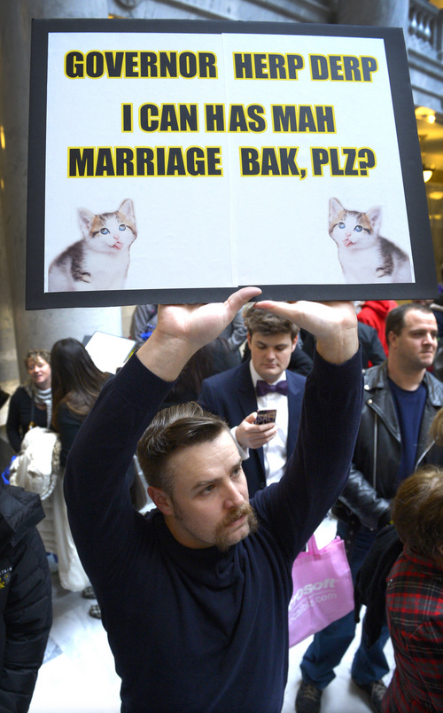 Rick Egan  | The Salt Lake Tribune   Tyler Kunz holds a sign during a rally at the Utah State Capitol in support of same-sex marriage, Friday, January 10, 2014.
