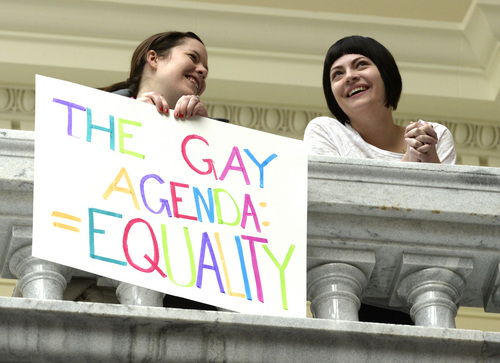 Rick Egan  | The Salt Lake Tribune   A couple holds a sign on the top floor of the Capitol during a pro-gay marriage rally, Friday, January 10, 2014.